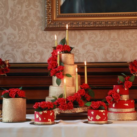 Gold and red luxury wedding cakes by Tees Bakery