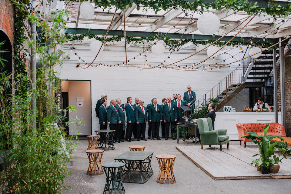 Welsh mens choir singing at a wedding