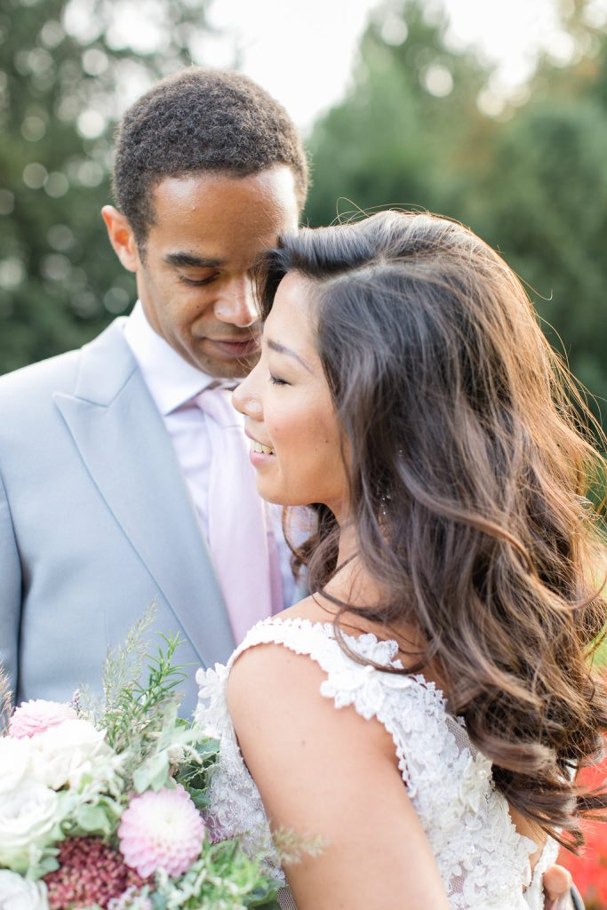 cliveden wedding in the rose garden with an asian bride and an african groom