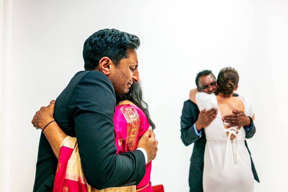 Tamil Polish wedding couple hugging with parents on wedding day