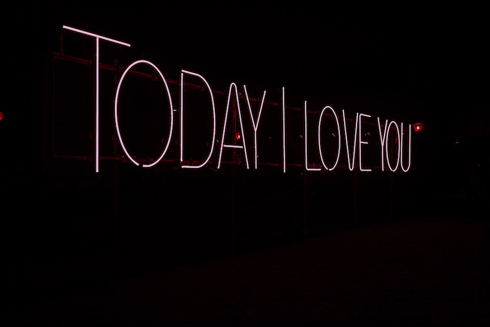 pink neon sign reads today i love you