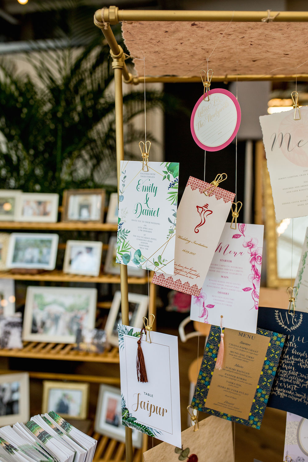 Wedding stationery hanging on display at a vendor stand for a London wedding industry event
